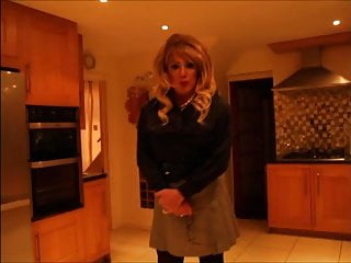 Sindy in black satin blouse and grey mini skirt
