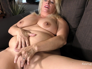 Plus-size mature fledgling glamour Ann leisurely undresses off her clothes