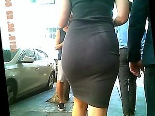 Enormous culo in taut sundress