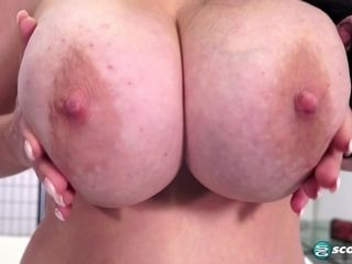 Supah huge-chested brown-haired mommy plays with her immense naturals in striptease sesh