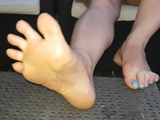 Showcasing my soles and knead my wooly fuckbox outside