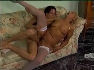 Blonde Granny in white stockings calls over a junior boy