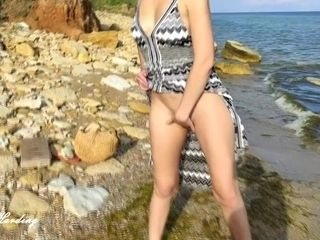 'Alice bares and shows her breasts and pussy, outdoors, on the beach, in the apartment and in the bar'