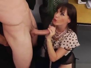 Deep-throating beauty is acting in dick sucking action in office