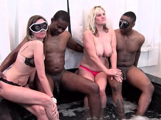 Blonde MILFs giving blowjob in Jacuzzi foursome