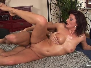 Oiled MILF Olivia enjoys passioante sex with young boy