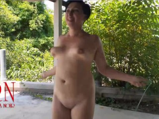 Naked woman jumping Her boobs are shaking Outdoor