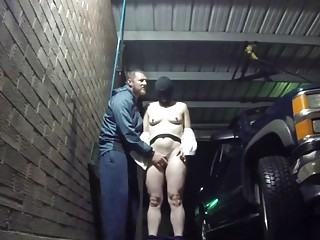 Naked and hooded at the car wash