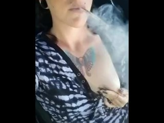 Smoking punk lady fumbling her muff and boobs in parking bunch