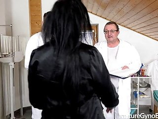 Hot mature brunette made to cum in gyno chair by 2 doctors