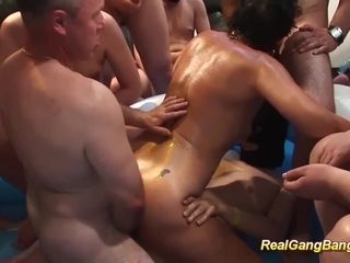 German female parent gets oiled with an increment of banged